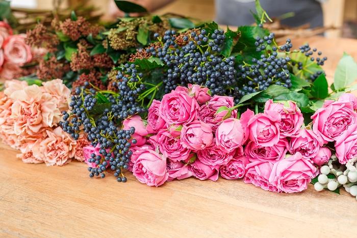 Flower shop background. Fresh roses for bouquet delivery. Floral design studio, making decorations and arrangements.